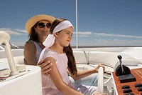 Mother and daughter driving boat (thumbnail)