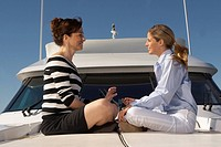 Women sitting on boat (thumbnail)