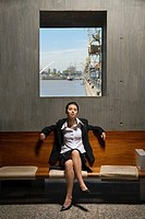 Young businesswoman sitting near docking area