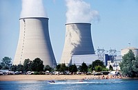 Nuclear power station. Cooling towers at the Belleville nuclear power station, Cosne_sur_Loire, France. A local market and leisure activities are taki...