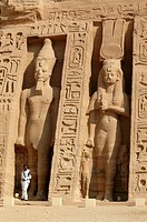 The Temple of Nefertari dedicated to Hathor _ Policeman at the foot of the statues of Ramesses II and Nefertari on the frontage of the temple