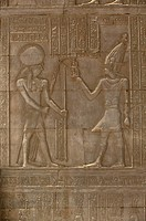 On the left part of this relief, Horus, the falcon_headed god