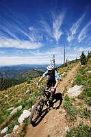 Man bikes the Seven Summits trail, Rossland, British Columbia, Canada.