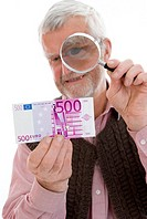 older man watching Euro banknote through the loupe