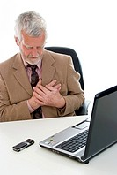 senior office worker with cardialgia