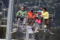 A young family on a chairlift, Whistler Mountain, British Columbia, Canada.