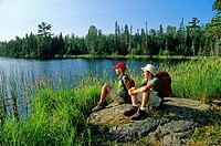 Teenage hikers at Lyons Lake, Whiteshell Provincial Park, Manitoba, Canada.