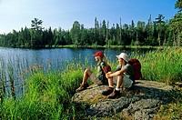 Teenage hikers at Lyons Lake, Whiteshell Provincial Park, Manitoba, Canada.