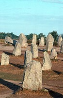The standing stones of the Menec Alignments near the village of Carnac on the south coast of Brittany in France. The stones were hewn from local rock ...
