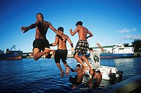 Cook Islands, South Pacific, Raratonga, local teens jump into harbour