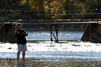 A man fly fishes on the Payette River in Idaho.