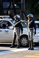 Female police officers directing traffic in Mexico City, Mexico.