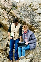 Geologists Abel Ramirez and Kim Tharp use a laptop to assist them in their work.