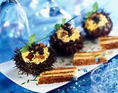 Scrambled eggs with caviar in sea urchin shell (thumbnail)