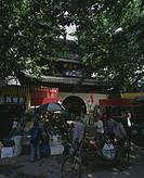 Mingyuan building, Gongyuan, Mausoleum of Fuzi, Nanjing, Jiangsu, China, Bicycle, people, stall, March
