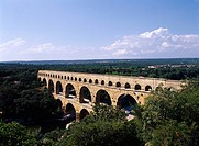 Acueductro Romano of a Pont du Gard Provence France Blue sky Clouds Tree Green