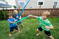 Children fighting with plastic saber swords  St Paul Minnesota USA