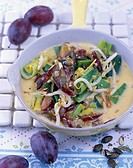 Leeks with sprouts and damsons in coconut curry sauce