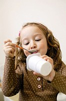 Girl eating yoghourt