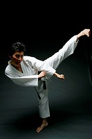 Player of karate, kicking