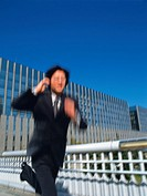 Businessman running, Blurred Motion