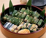 Sushi Wrapped In Bamboo Grass
