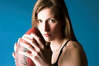 Female Model holding Football