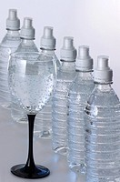 Water bottles and sparkling water in a glass