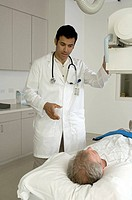 Portrait of doctor treating older patient