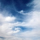 Wispy cloud formations against clear blue sky (thumbnail)
