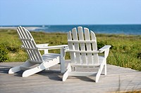 Adirondack chairs on deck looking towards beach on Bald Head Island, North Carolina