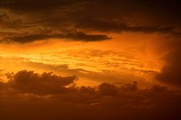 Golden yellow and orange sunset sky and clouds