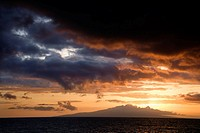 Sunset over Pacific Ocean and Kihea island in Maui, Hawaii, USA