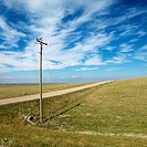 Power lines alongside dirt road in rural South Dakota (thumbnail)