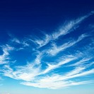 Wispy cirrus clouds in blue sky