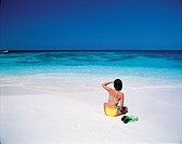 A Woman Sitting On Beach,Maldive Islands