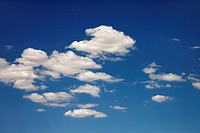 White puffy clouds in blue sky
