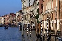 Gondola and striped mooring posts on Grande Canal