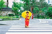 Boy Crossing The Road With Yellow Umbrella,Korean