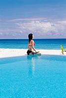 Korean Woman Practicing Yoga at the Beach, Maldives