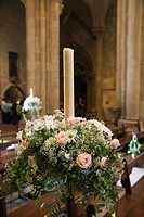 Interior with flower bouquet and candle of Se Cathedral, Lisbon, Portugal