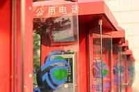Red Public Telephone Booths in Line