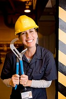Smiling worker with wrench