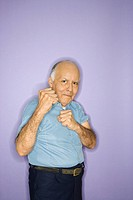 Caucasian mature adult male making fists.