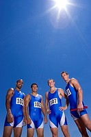Male athletes, smiling, portrait, low angle view, lens flare