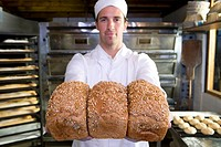 Baker with loaves of bread, portrait (thumbnail)
