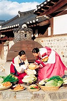 Women In Korean Costume Making Kimchi,Korea