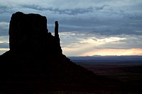 Mitten Butte silhouetted in a sunset.