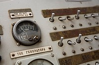 Riverboat wheelhouse switches, dials with Russian and Chinese writing.