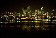Lights of downtown Seattle reflect across Lake Union.